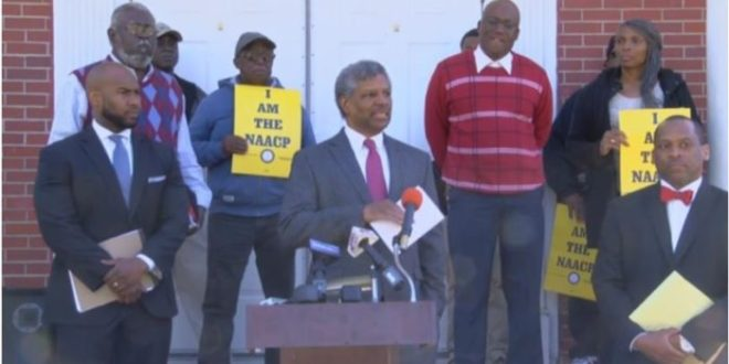 NAACP SUES CITY